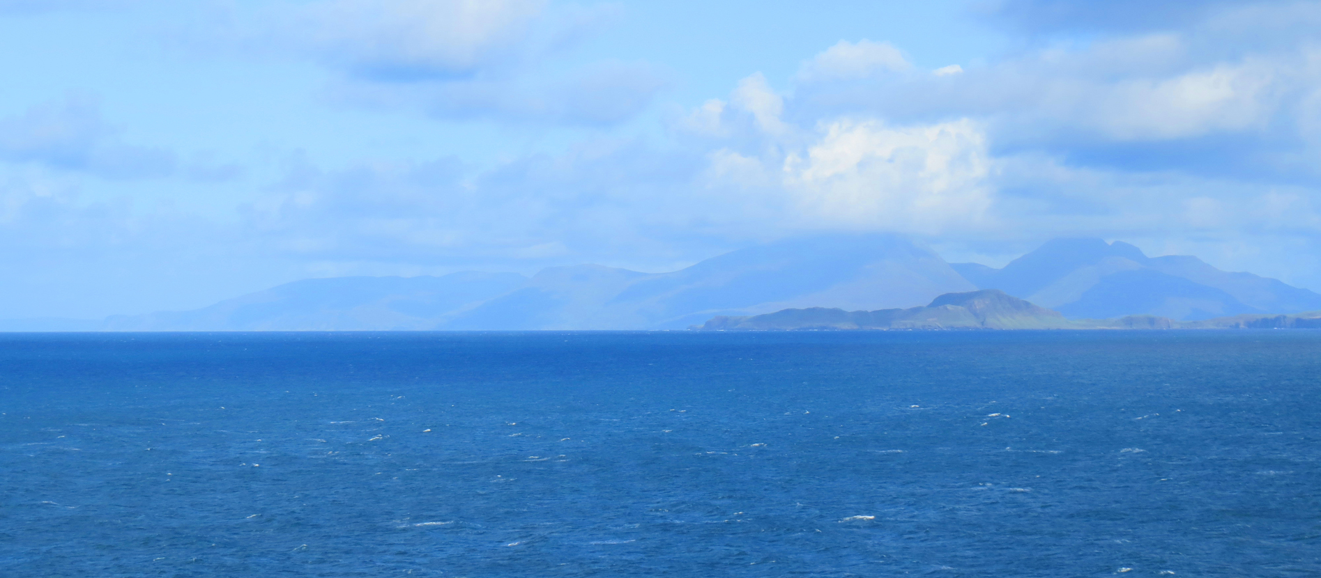 the-isle-of-eigg-with-rum-isle-in-the-background-from-sanda-bay