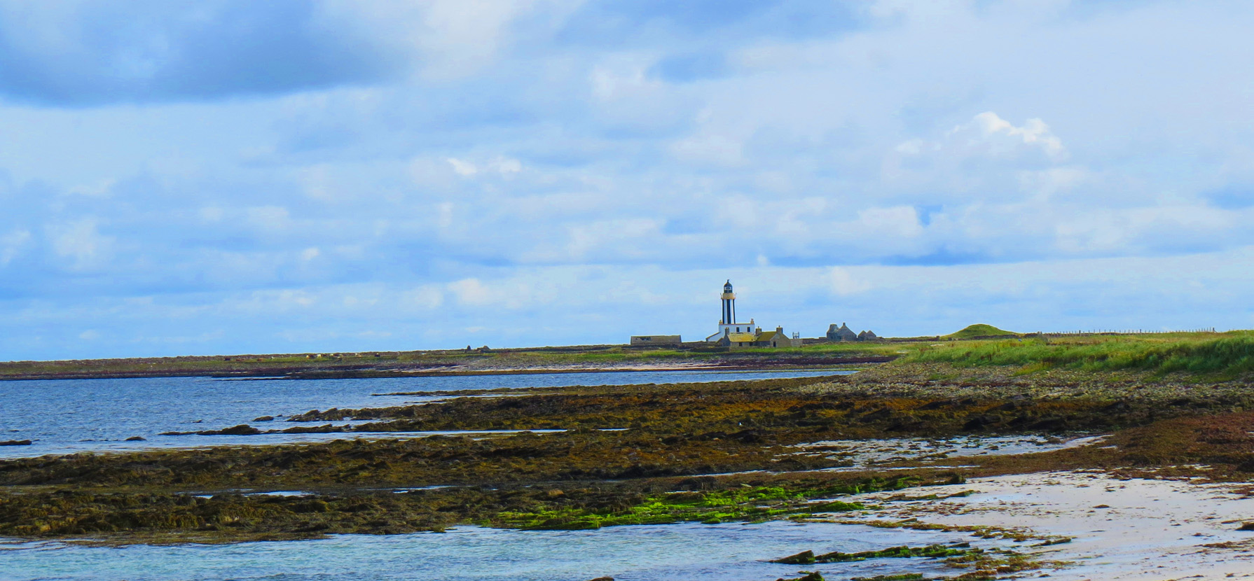 lighthouse and buried cottage on sanday